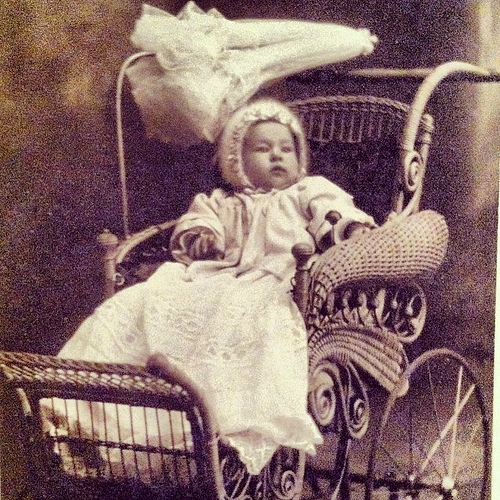 #baby in an #antique #buggy. #1900s #1910s #antiquephoto #antiquepicture #infant #stroller #wicker #parasol - @creneh1992